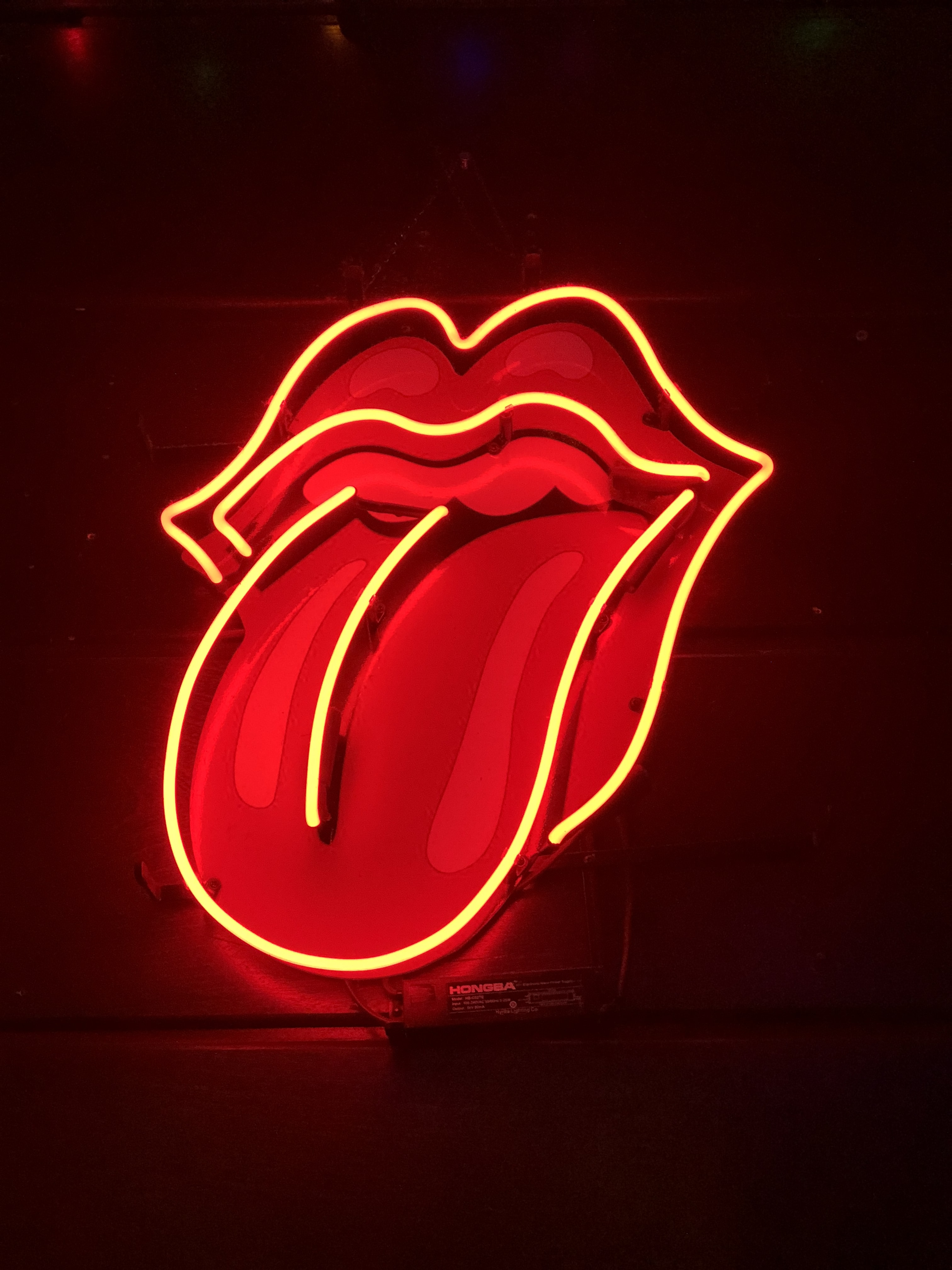 red tongue out neon light signage turned on