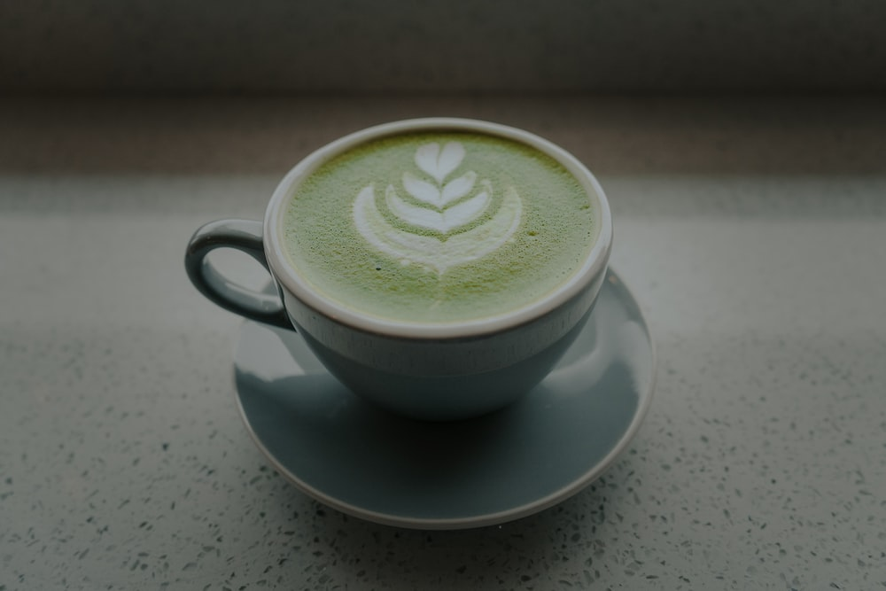 grey ceramic mug with grey saucer