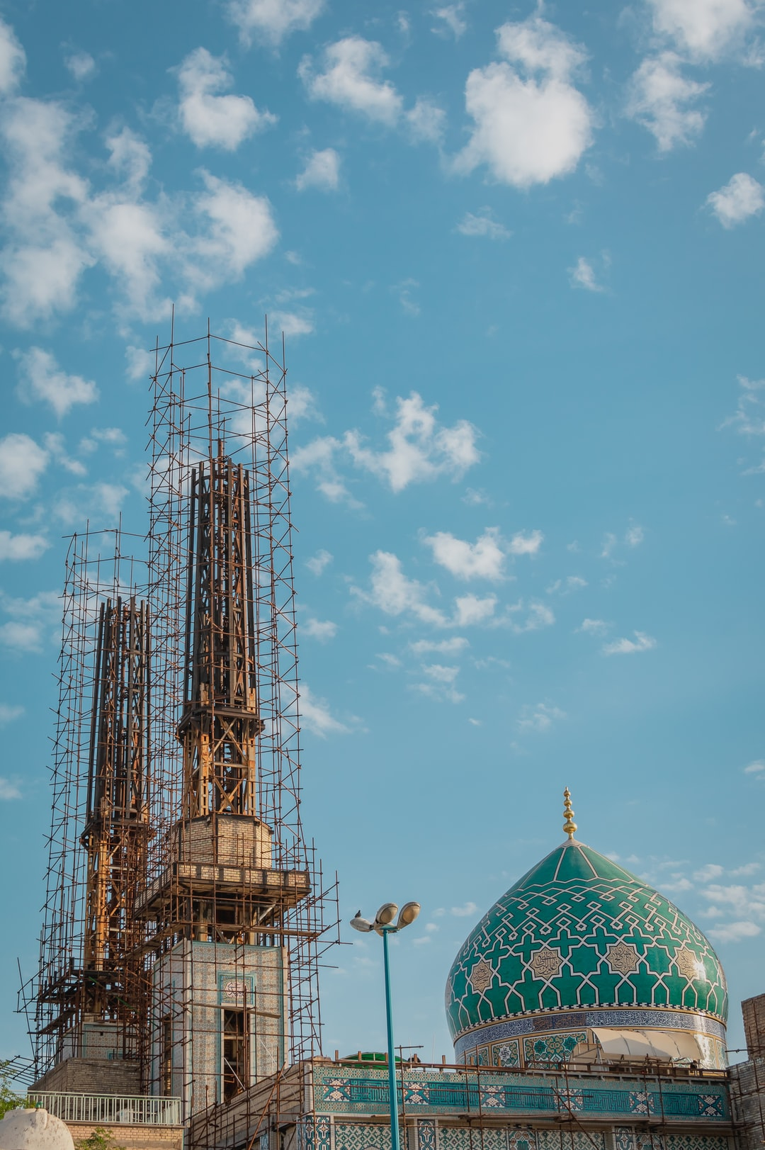 The shrine of Ali Ibn Mahziar. The dome has turquoise  tile work which is characteristic of Islamic architecture and the minarets are being being repaired.