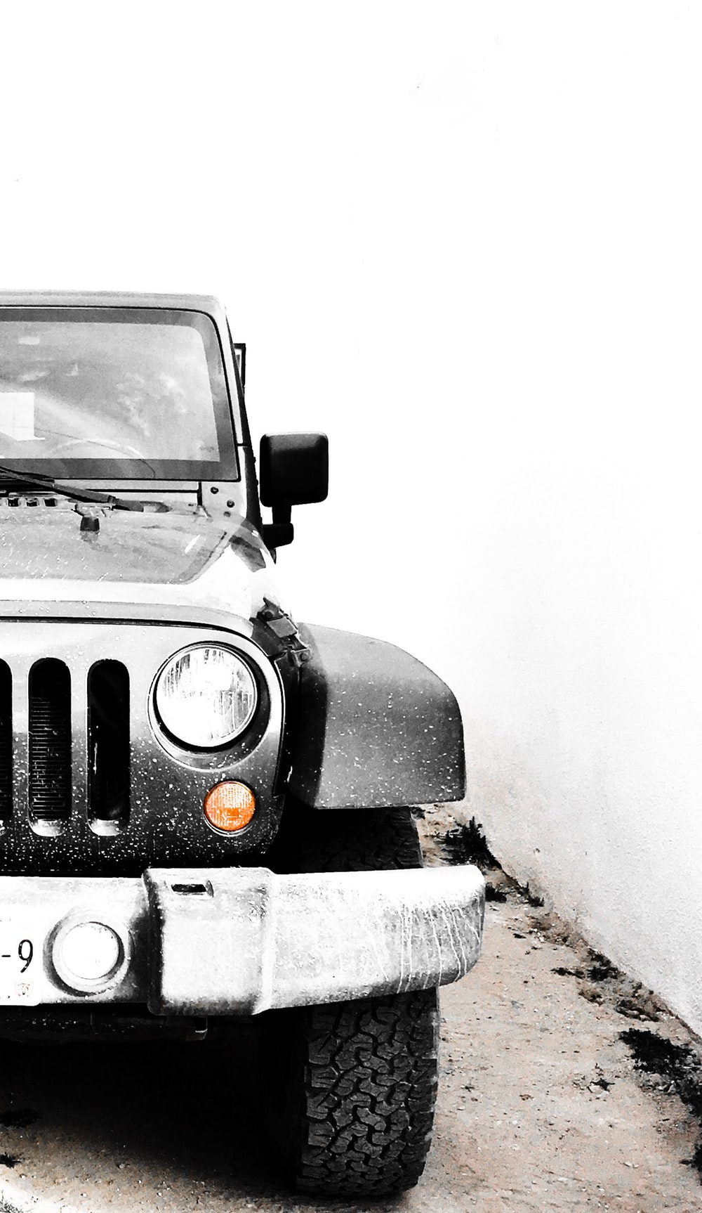 grey Jeep Wrangler on snow-covered ground during daytime