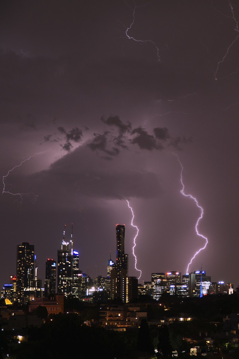 time lapse photography of highrise building under lightning