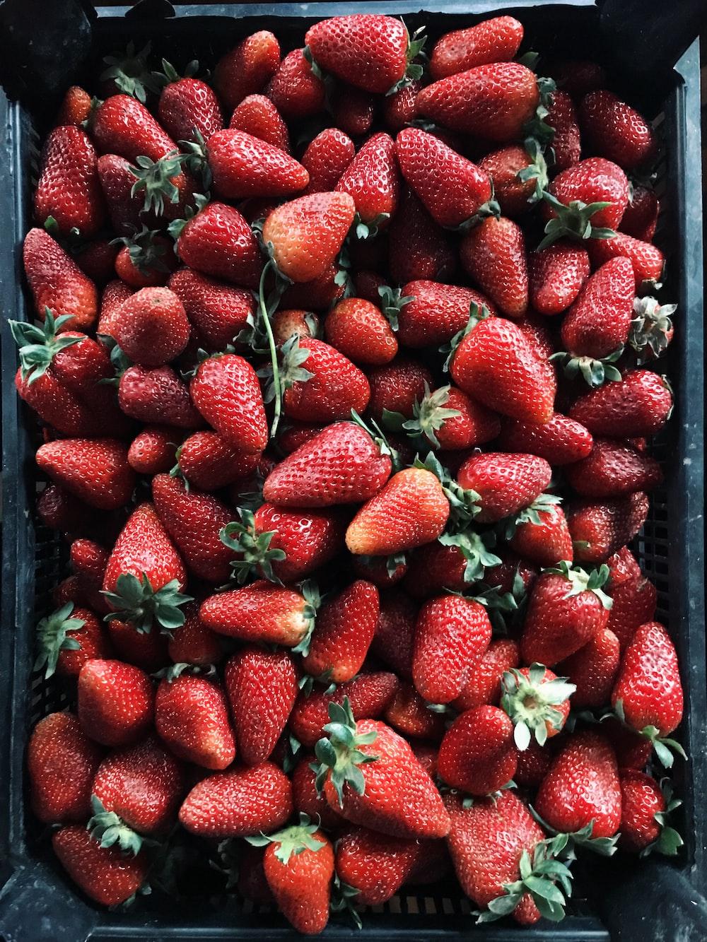 strawberry lot on black plastic crate