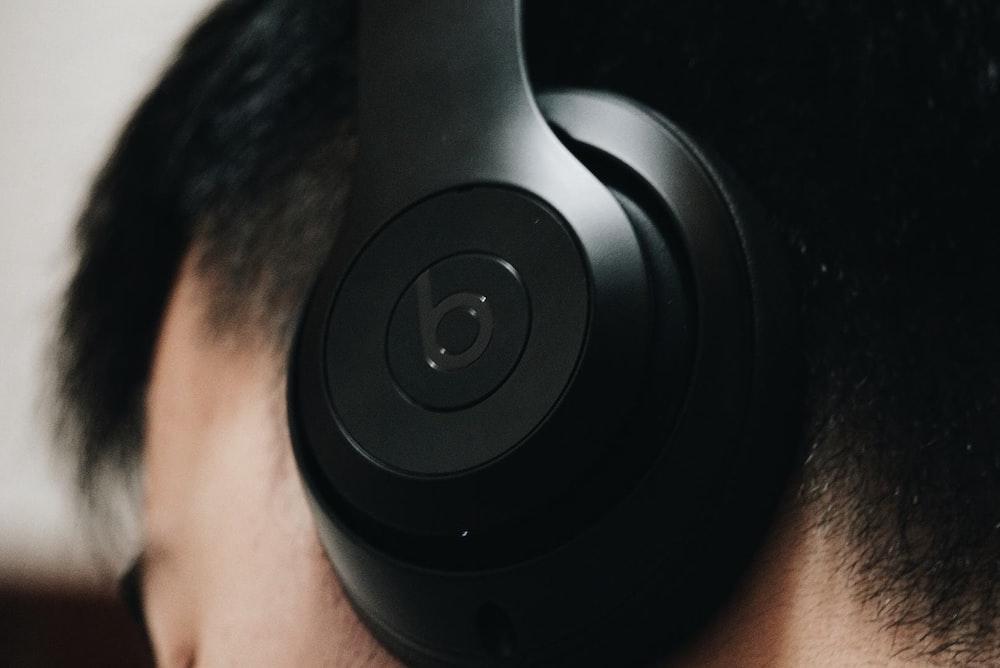 man wearing black Beats headphones - binaural beats