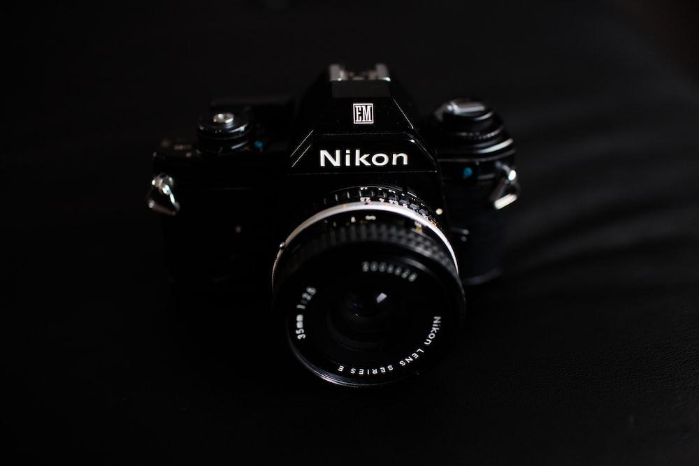 black Nikon bridge camera on gray textile