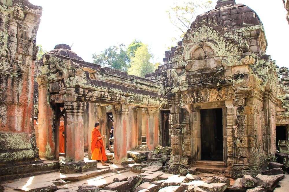 people walking inside ancient temple during daytime
