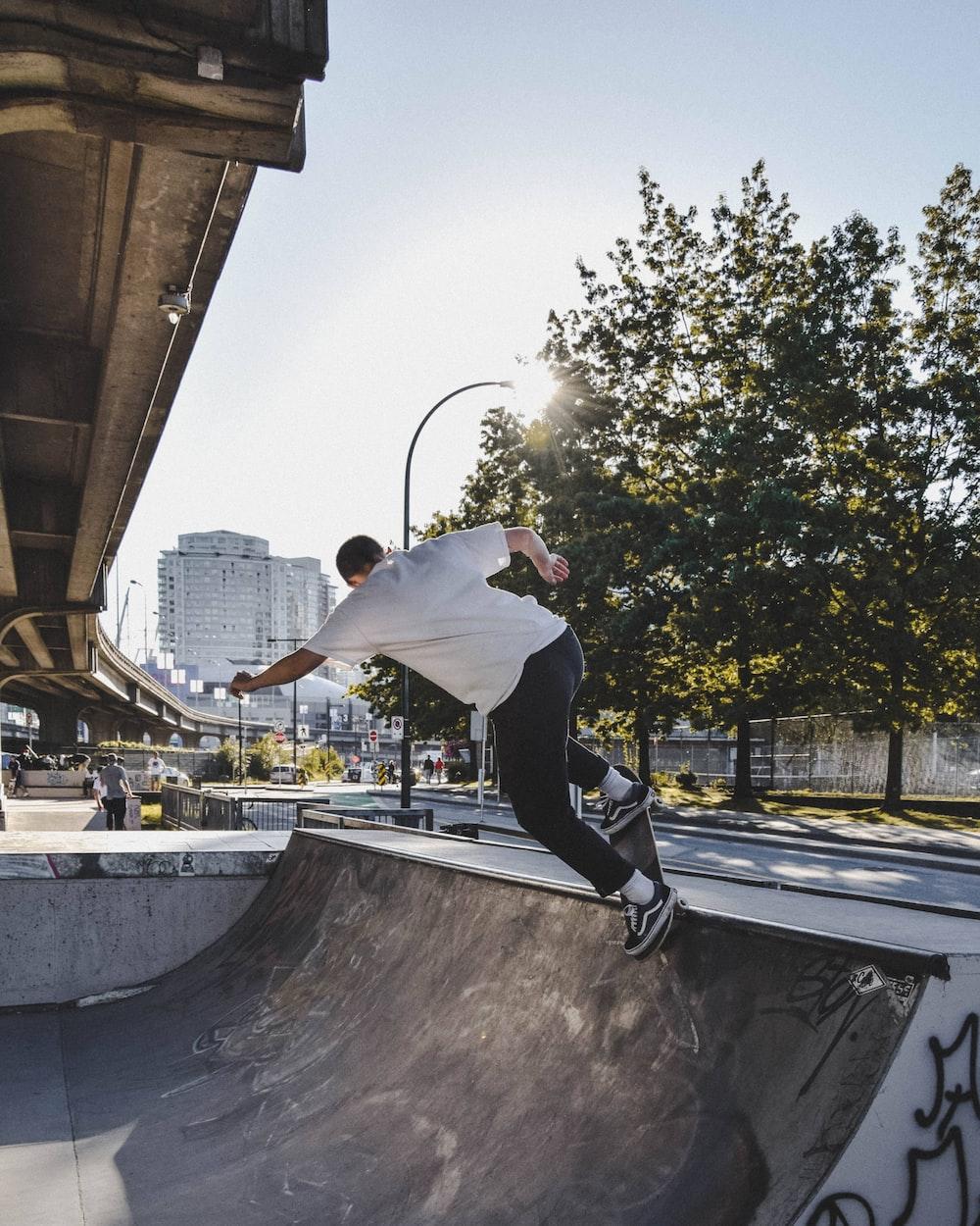 man skating on ramp