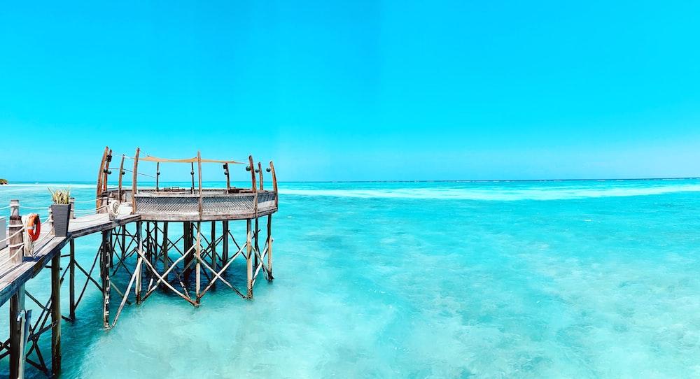 gray wooden dock under clear blue sky