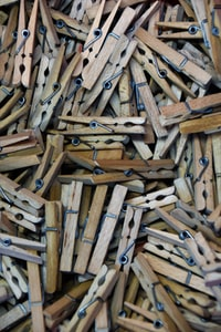 brown wooden cloth pin lot display