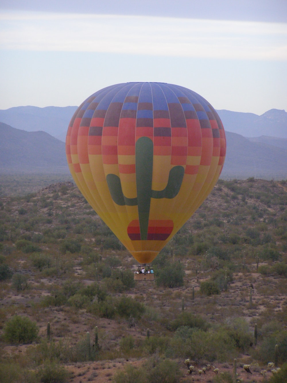 people riding hot air balloon during daytime