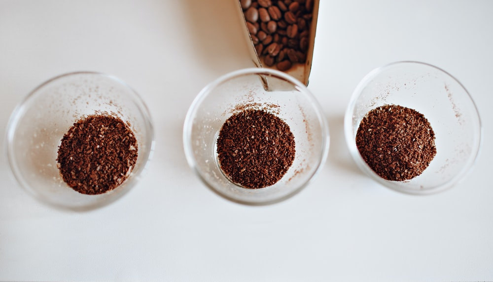 three clear glass cup filled with coffee grains