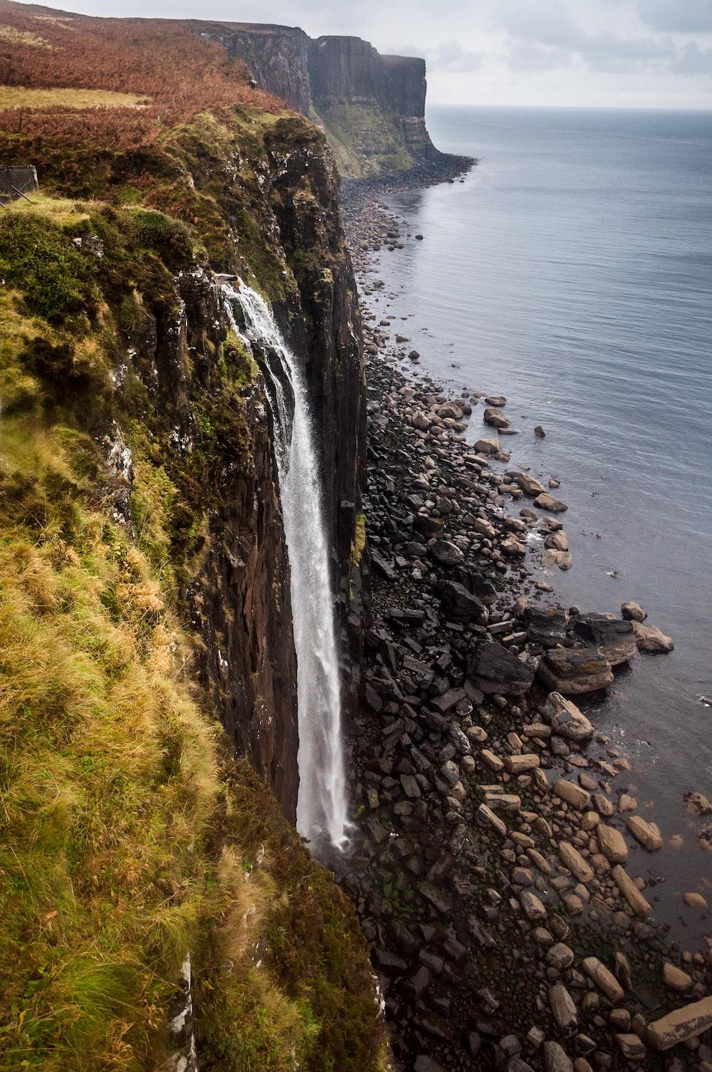 waterfalls viewing calm sea during daytime