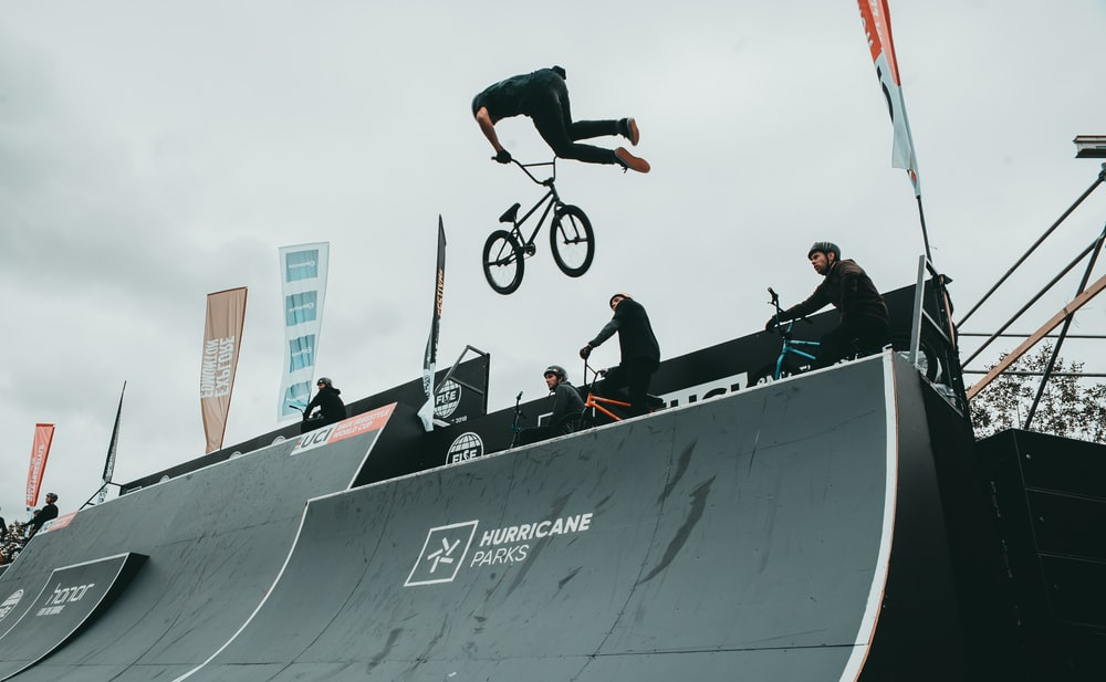 man doing freestyle bicycle on mid-air