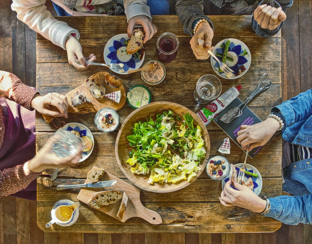 people eating on brown wooden table