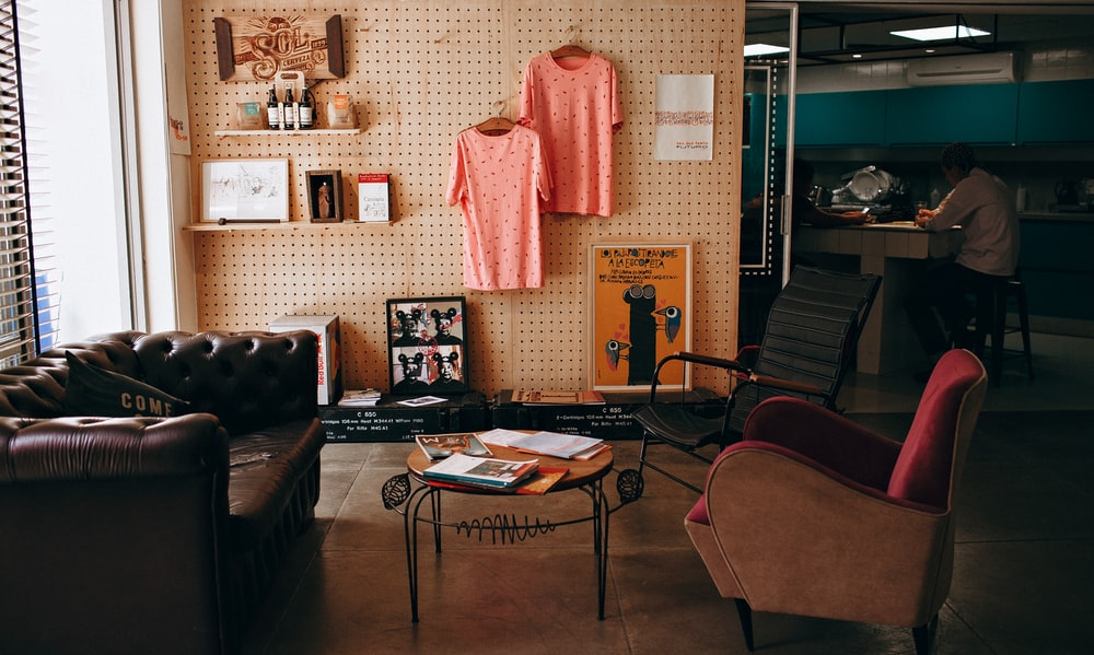 two pink shirts hanging on wall