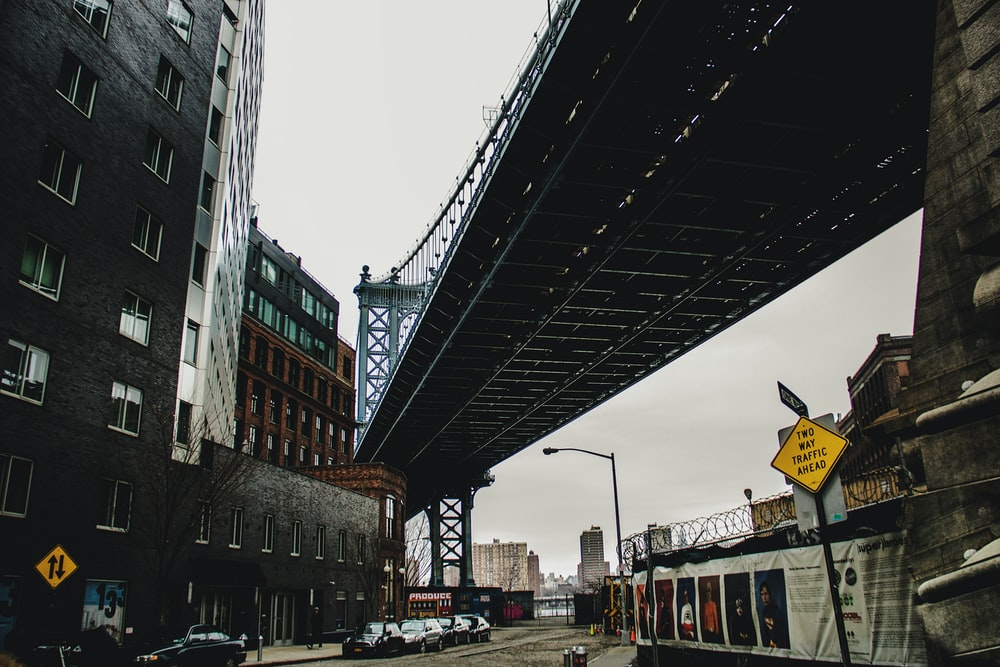 low-angle photography of Manhattan Bridge during daytime