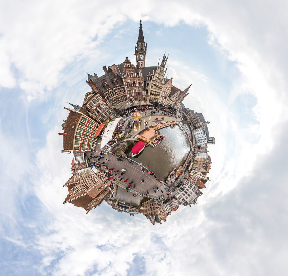 360 photography of building by the river with boats