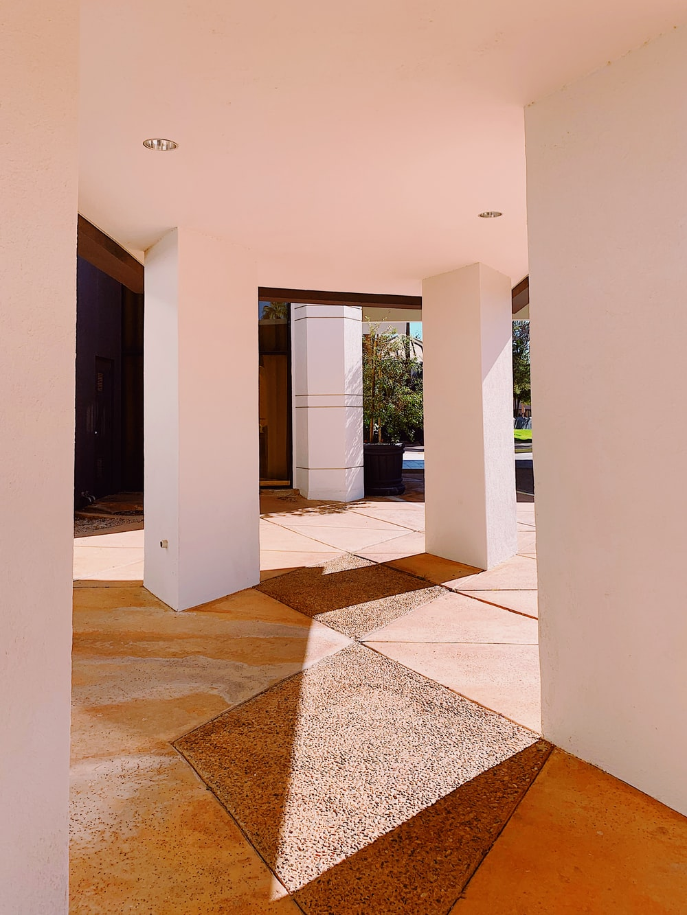 white pedestal column