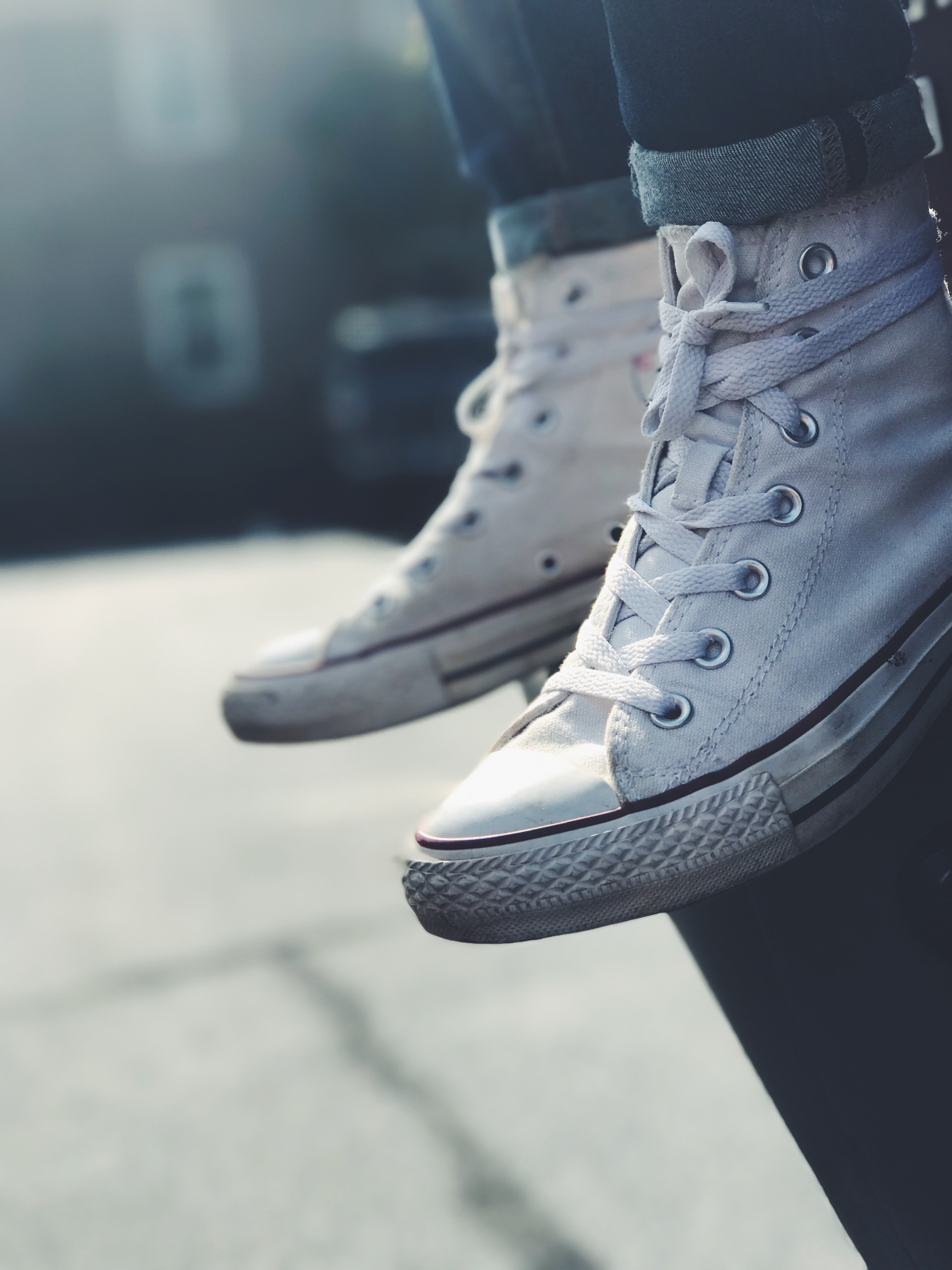 low-angle photography of person wearing white mid-high sneakers