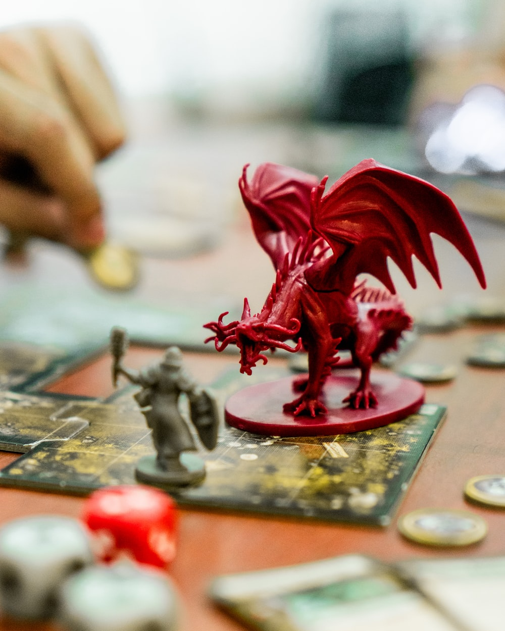 red dragon action figure on table