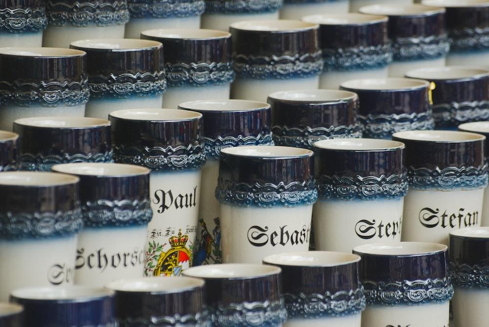 white-and-black ceramic mug lot