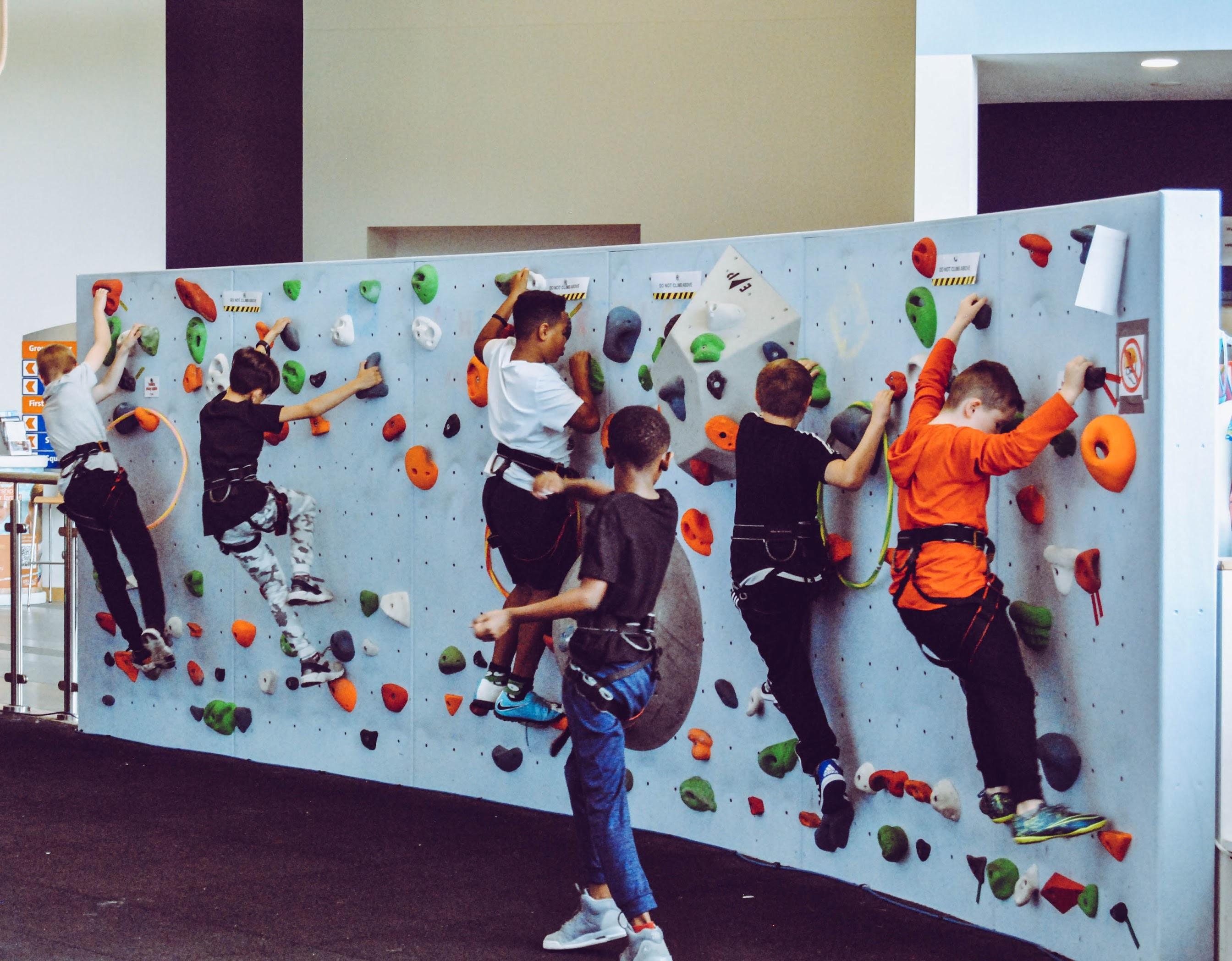 kids on test climb rock