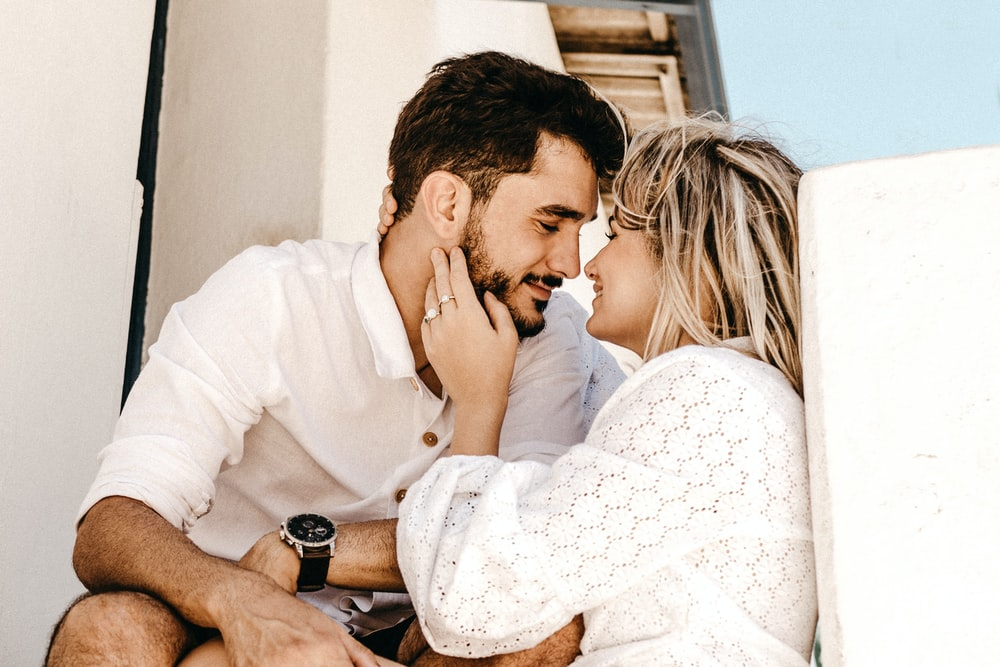 smiling man and woman about to kiss
