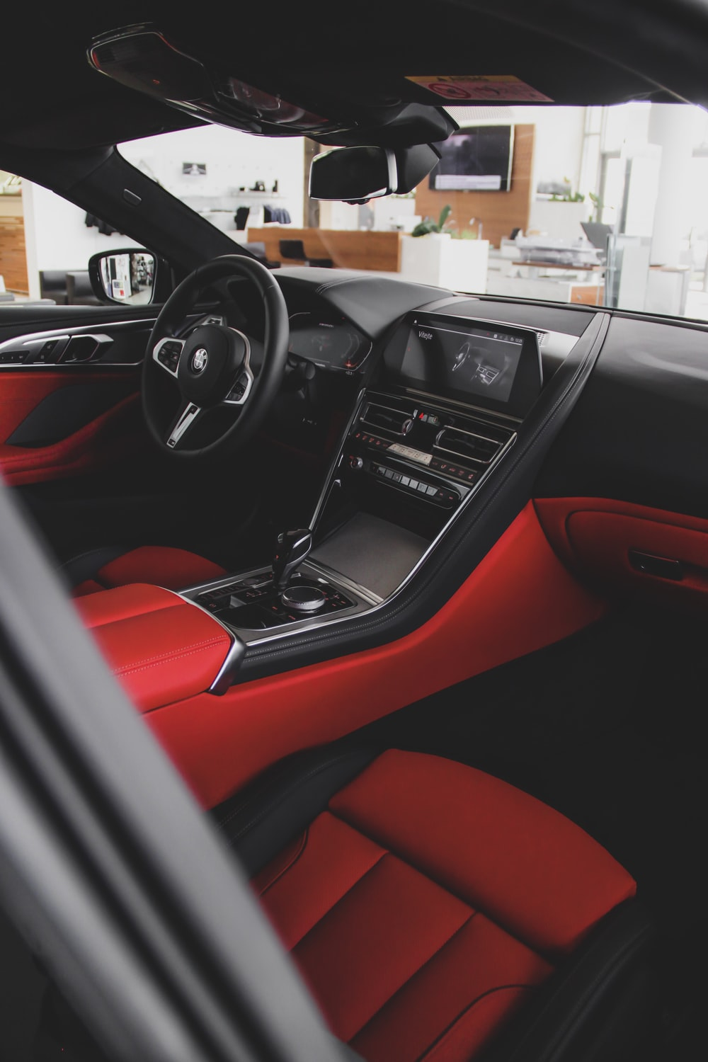 black and red car interior during daytime