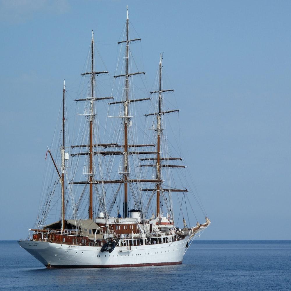 white ship on blue ocean water during daytime