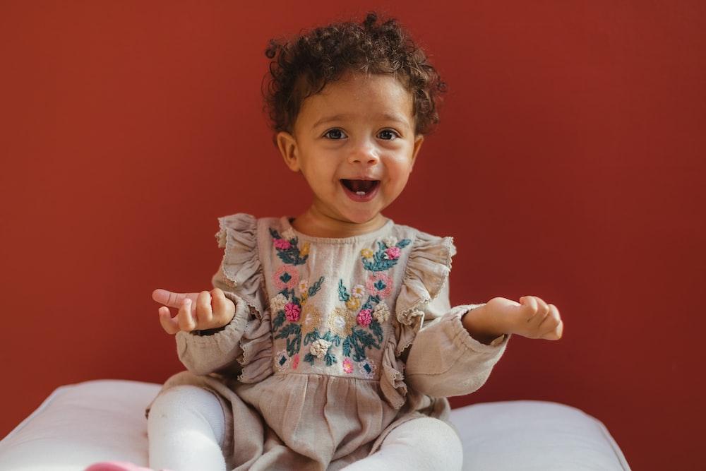 baby girl wearing grey dress and white socks