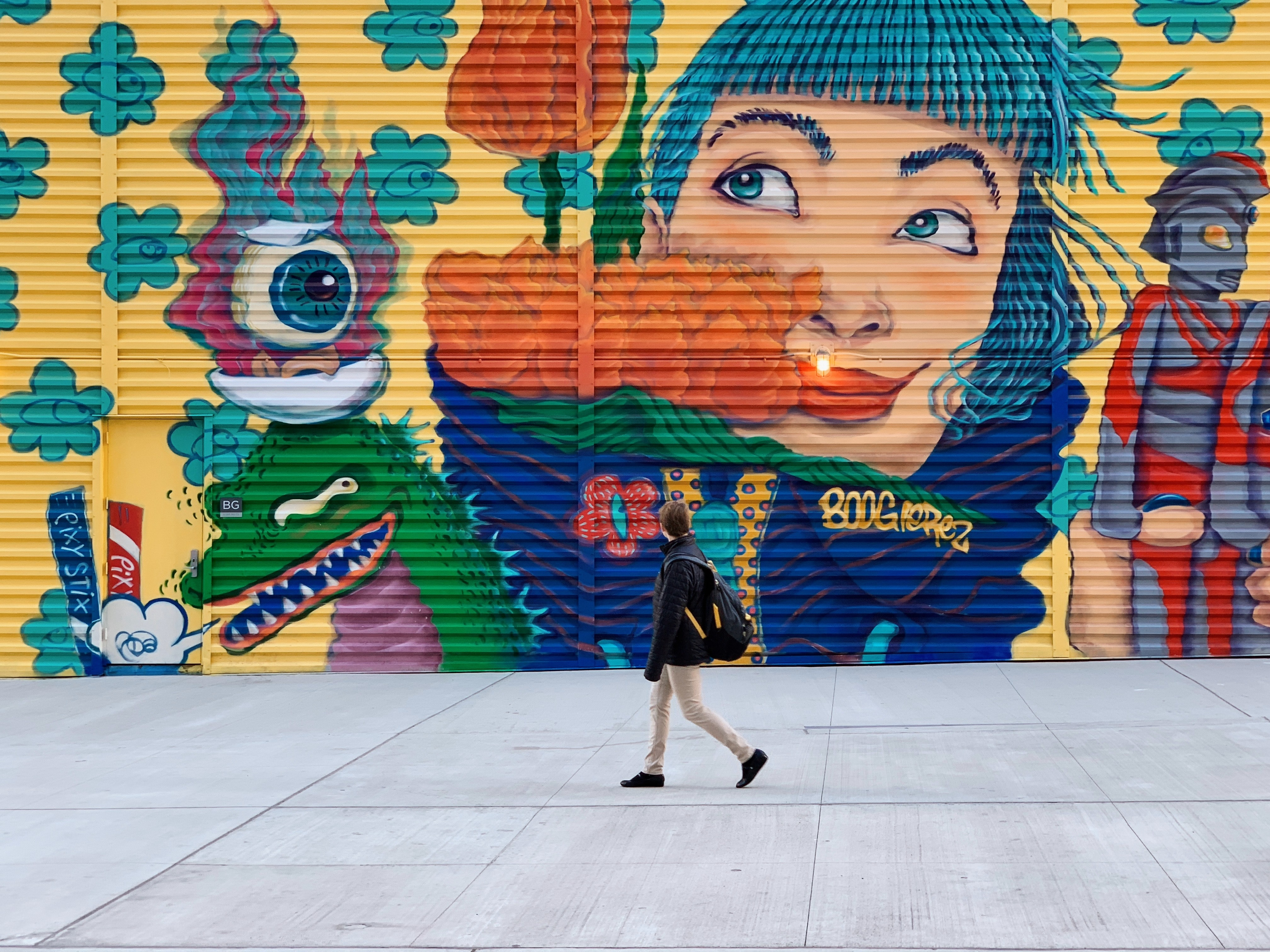 person standing in front of wall art