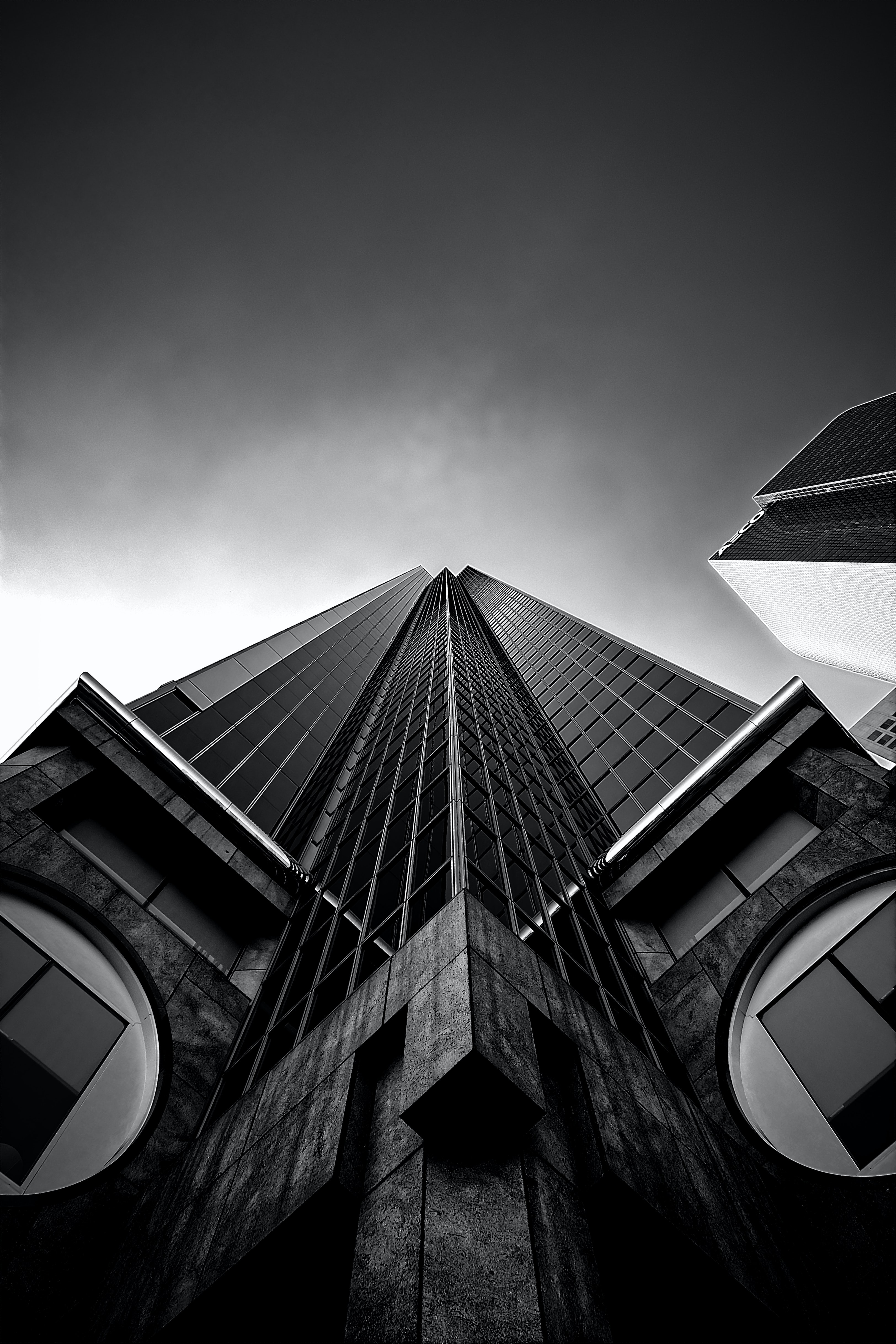 high-rise building greyscale photography