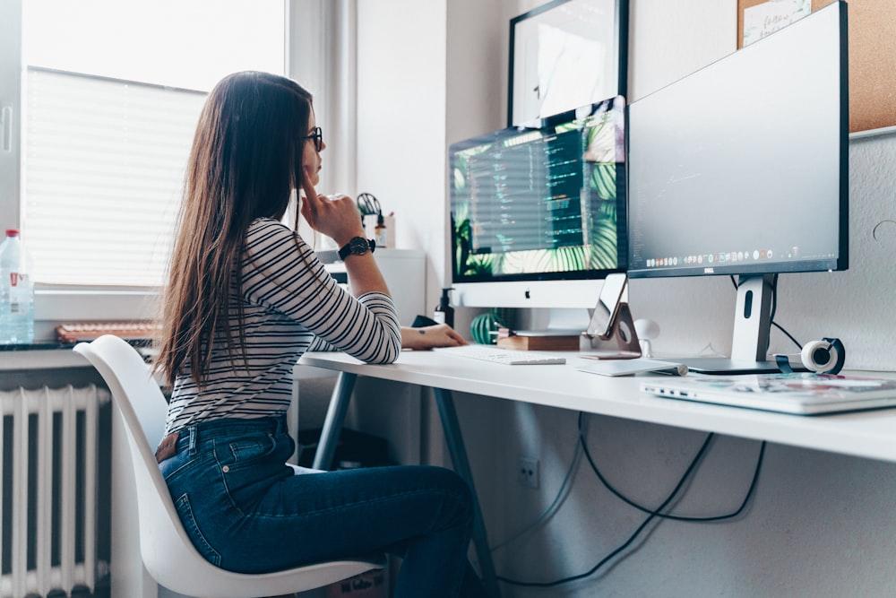 girl using desktop computer in room