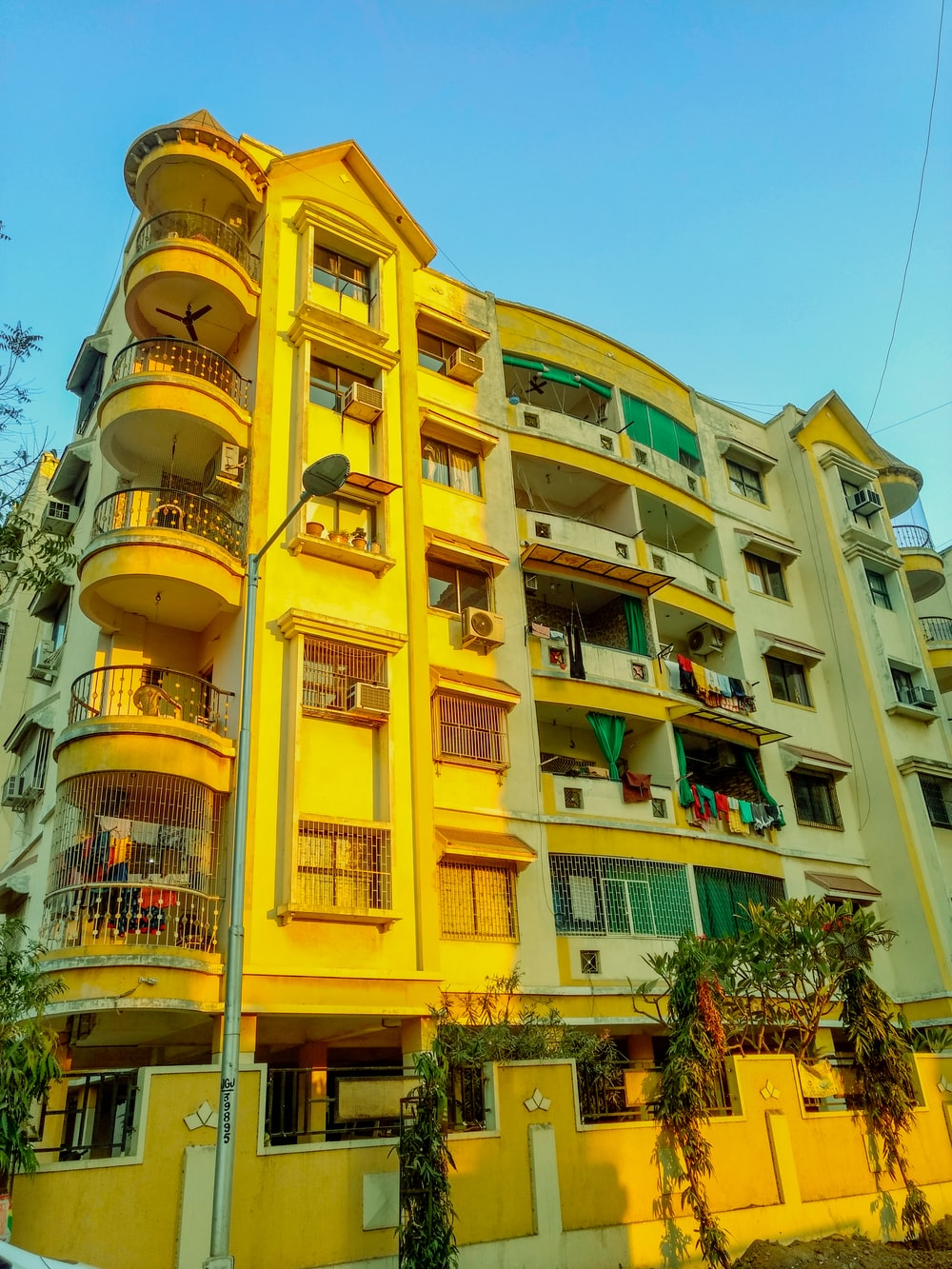 yellow and green concrete high-rise building