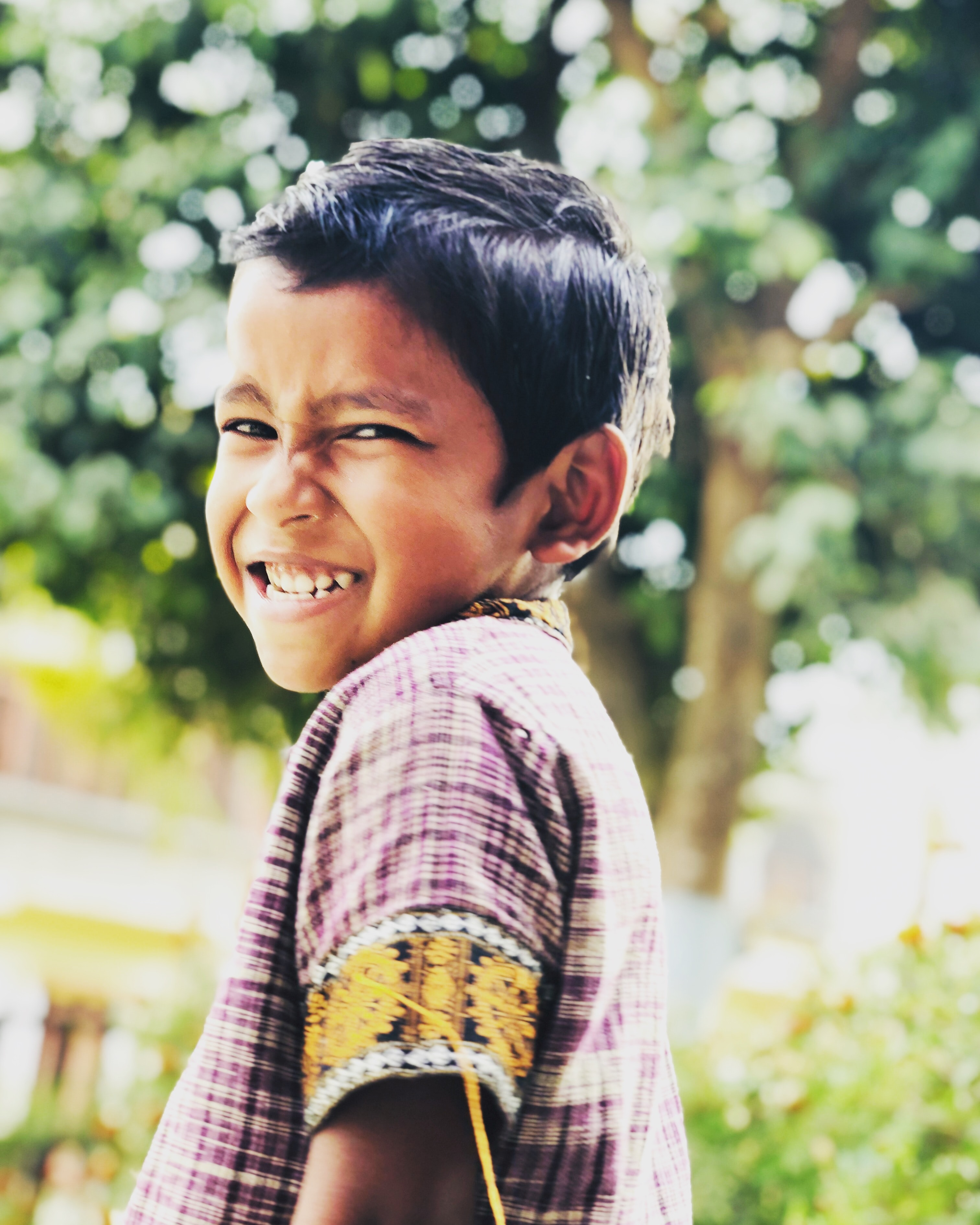 smiling boy looking side view