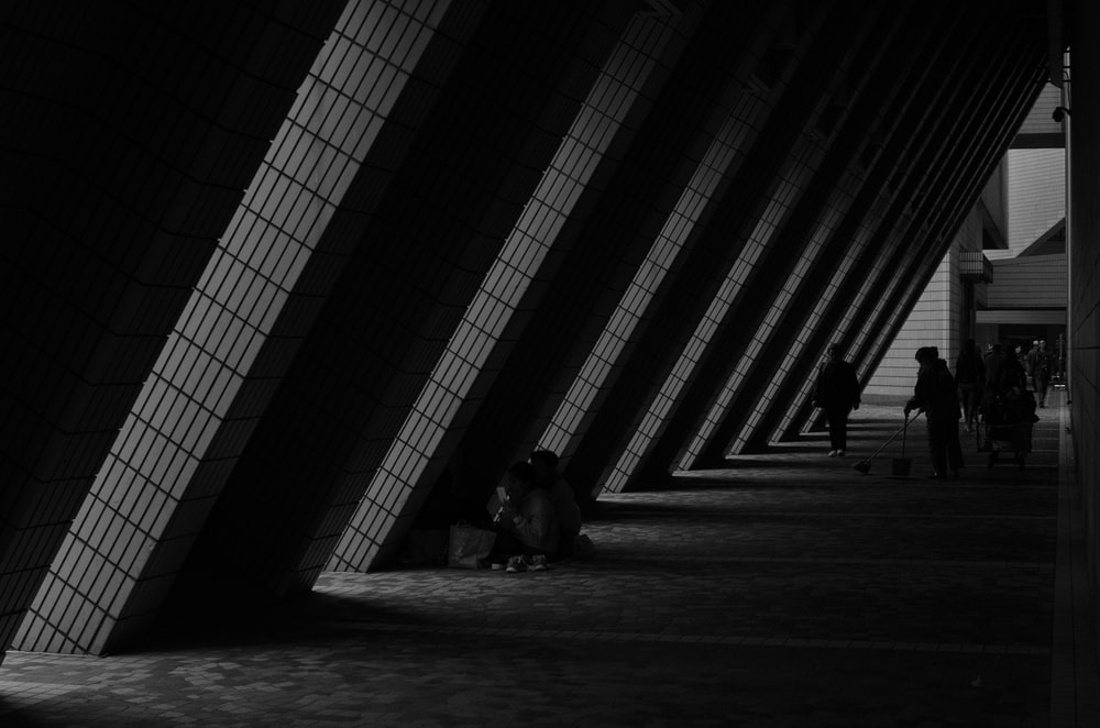 people under gray building