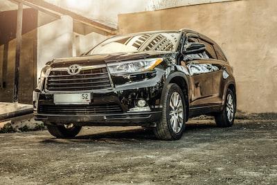 black toyota 5-door hatchback park during daytime vehicle zoom background
