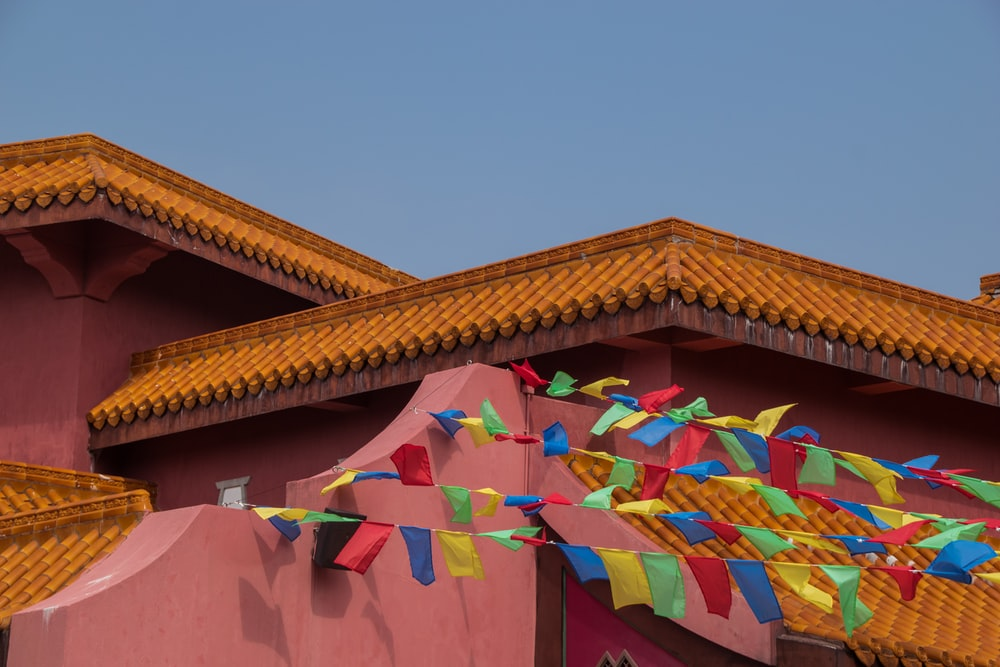 assorted-color buntings ties on roof of building under gray skies