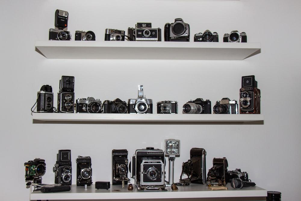 black and gray camera lot on shelf