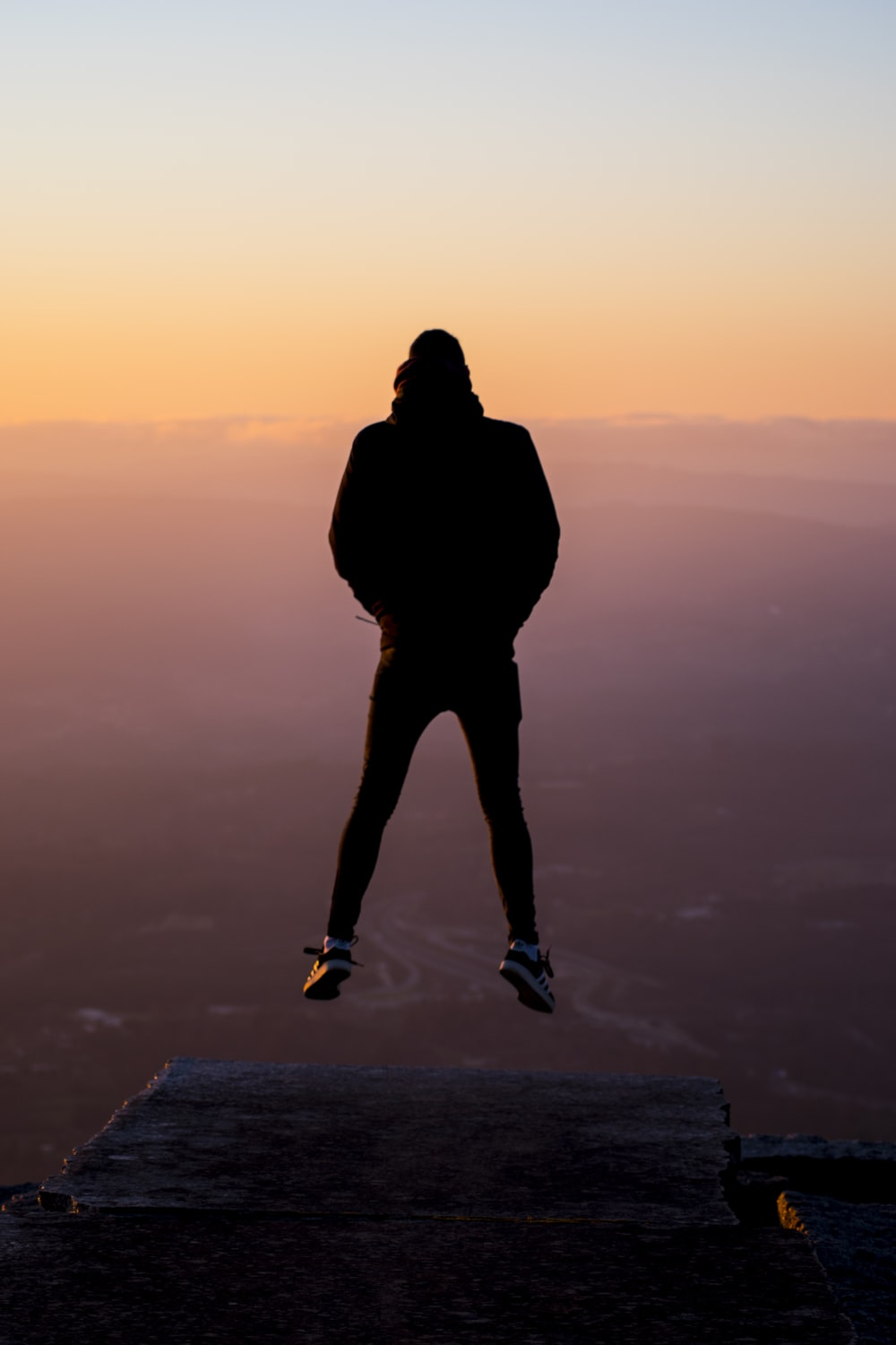 silhouette photography of person jumping