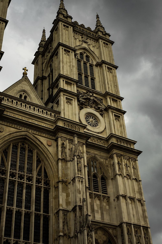 brown cathedral under gloomy sky