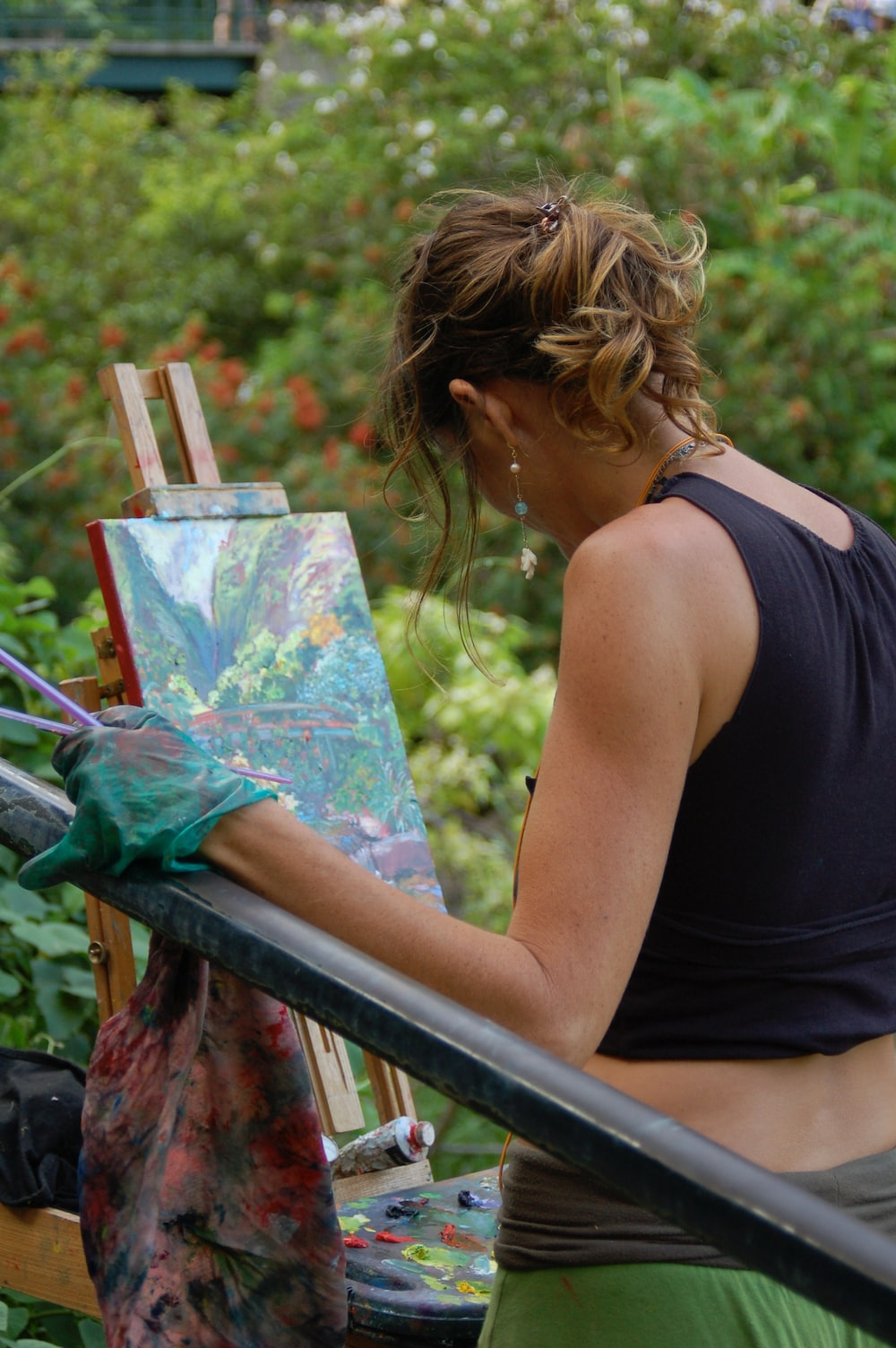 woman doing painting during daytime