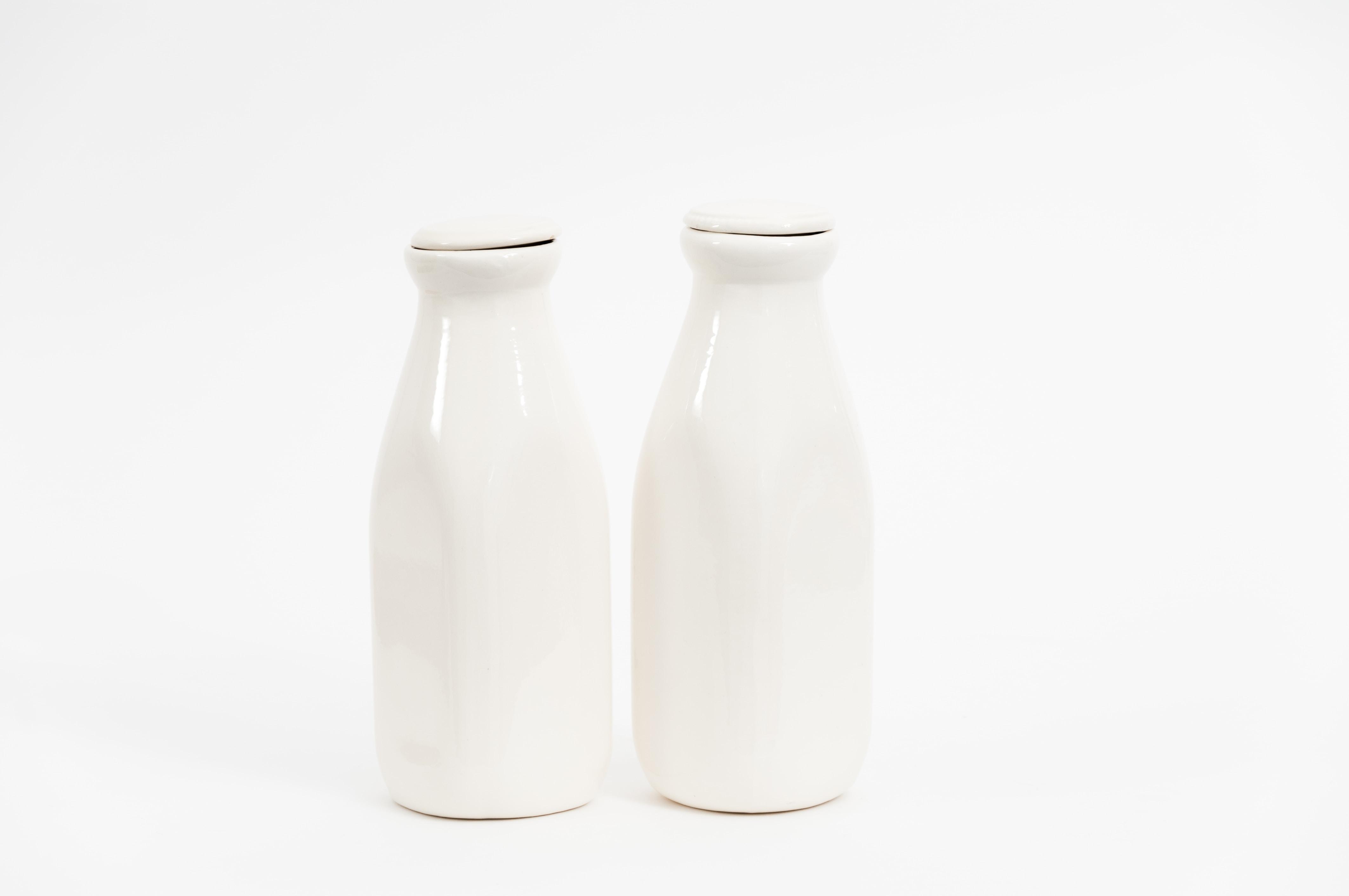 two white milk bottles