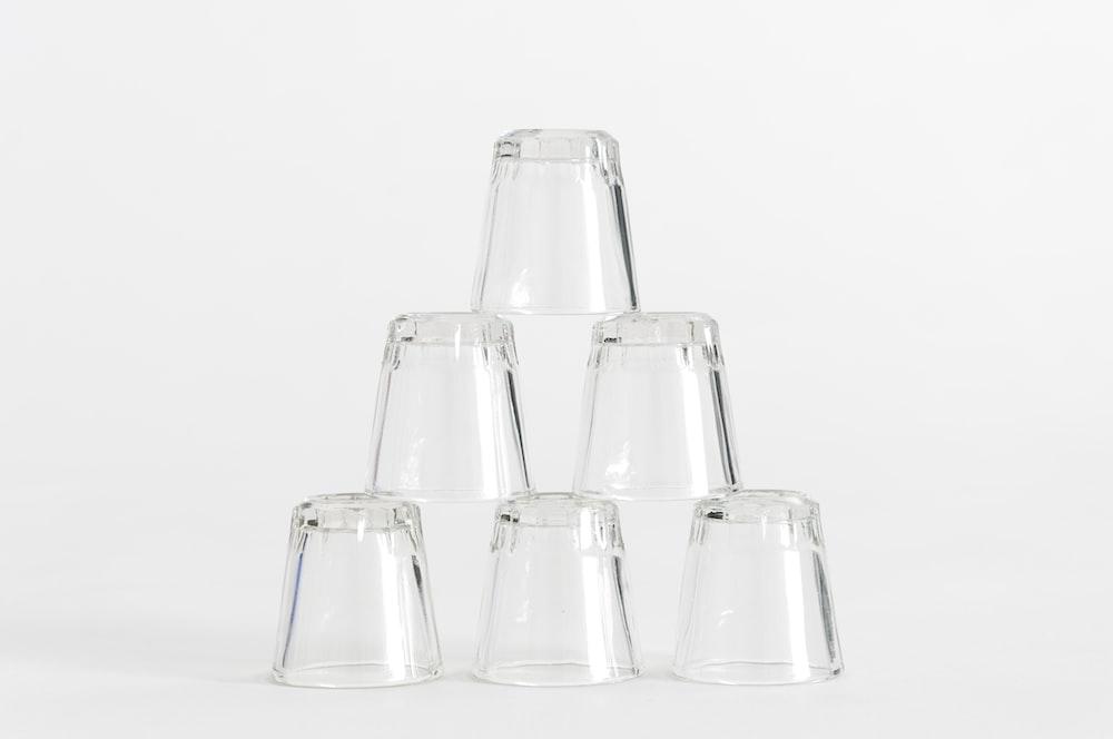 six piled clear shot glasses