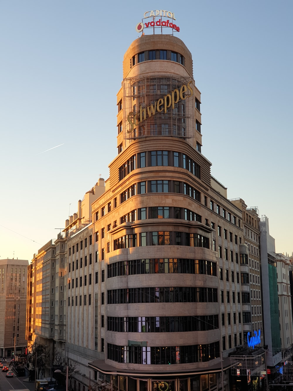 brown Schweppes building during daytime
