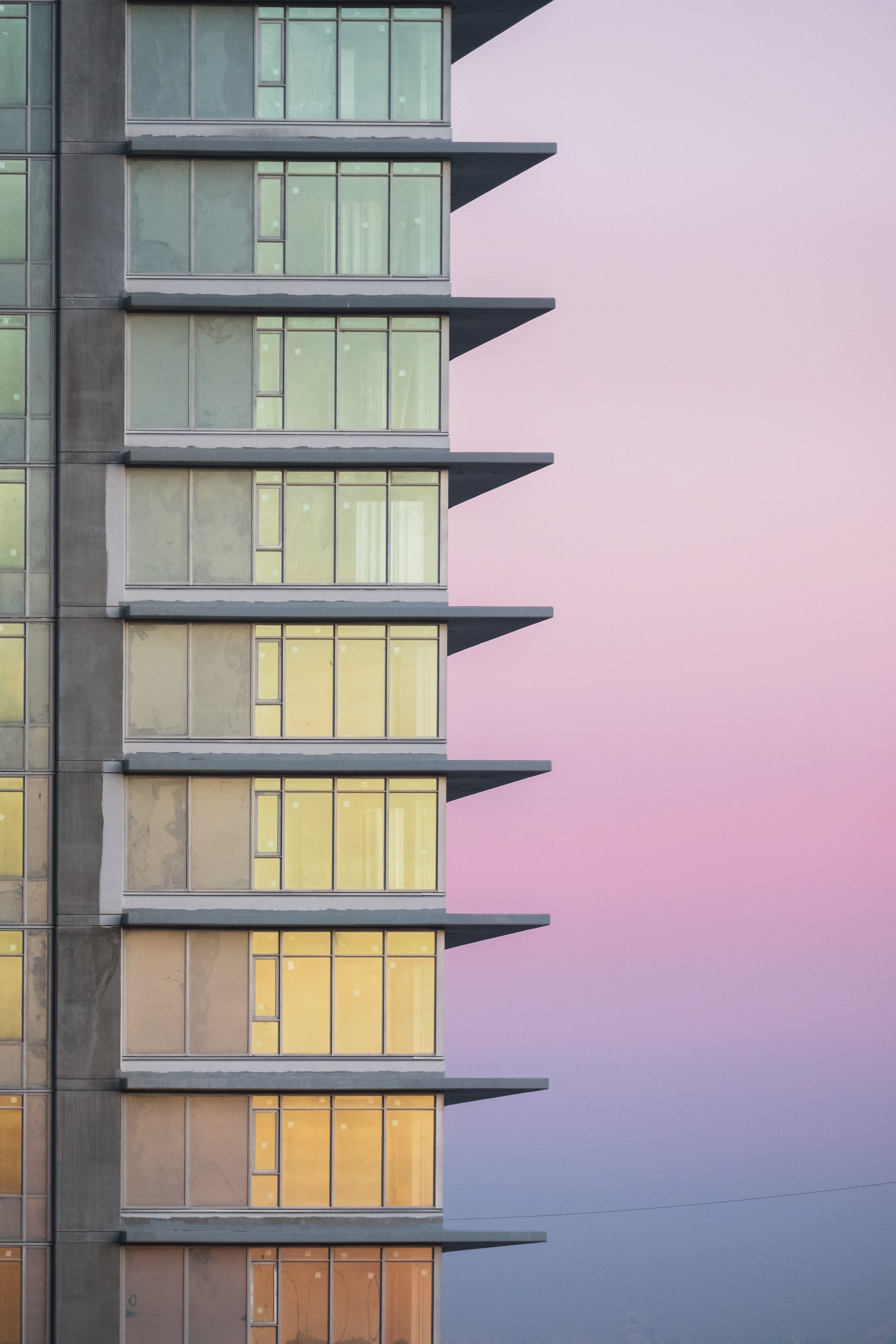 curtain wall high-rise building during daytime