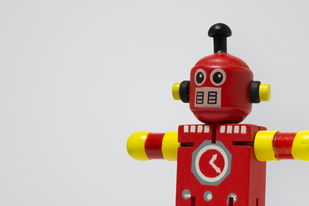 red and yellow robot clock toy