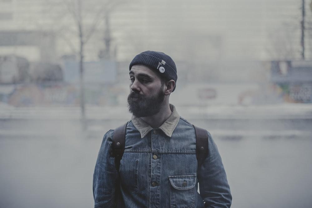 man standing on street during daytime