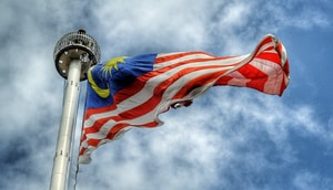 low angle photography of waving flag of Malaysia during daytime