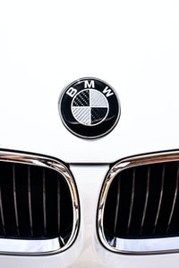 close-up photography of white BMW vehicle