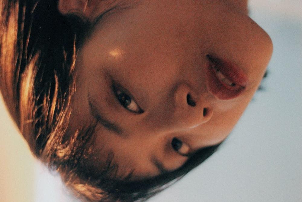 closeup photo of woman face